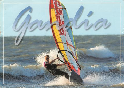 A man windsurfing in Gandia, Spain.